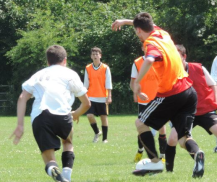 (Exhibit B.) Taken during a charity match earlier this summer. Oh, and there's the weird arm motion AGAIN!